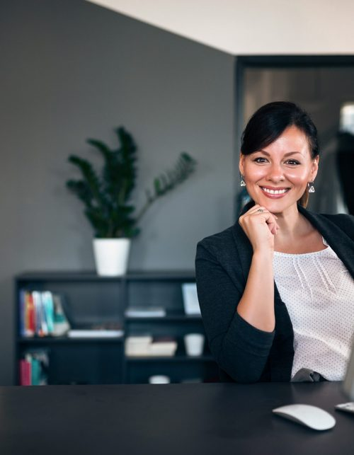 Smiling businesswoman at work.